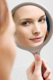 Lady looking at face in mirror