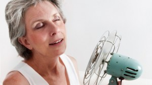 Woman having hot flashes